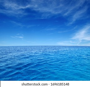 Close up of sea wave. Summer sunny day, blue sky, white clouds and water background.