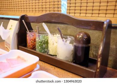 Close up of Seasoning set in Shabu shabu and Suki yaki resturant.