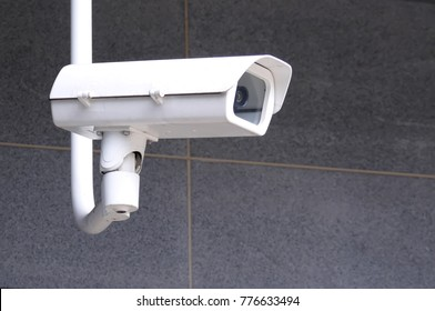 Close up of security cameras on wall at park