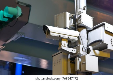 Close up of security cameras and traffic light on street at night