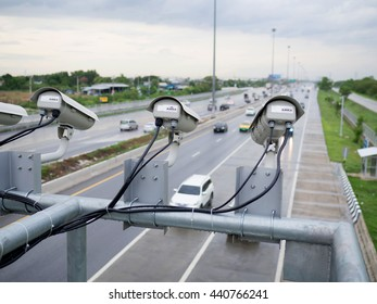 Close up Security CCTV camera operating over the road