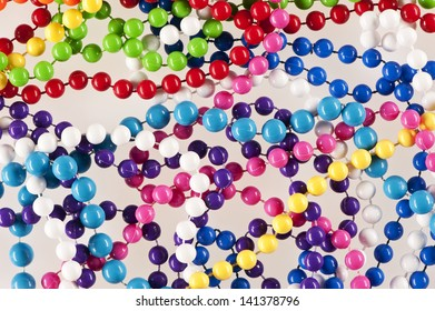Close up of selection of bright and colourful beaded necklaces.