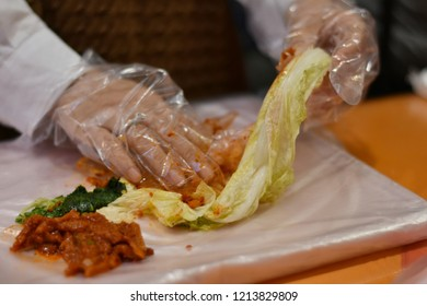 Close up and selective focus of Asia female hands are doing kimchi.Food preservation of Korean.