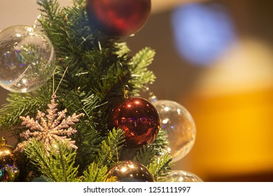 Close up and selective focus Cristmas ball hanging on Cristmas tree with copy space.