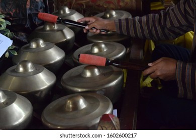 Close up selective focus hands playing gamelan music