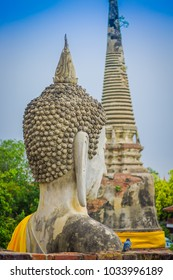 Close up of selective focus of the head of ancient Buddha Statue at WAT YAI CHAI MONGKOL, The Historic City of Ayutthaya, Thailand, in a blurred background