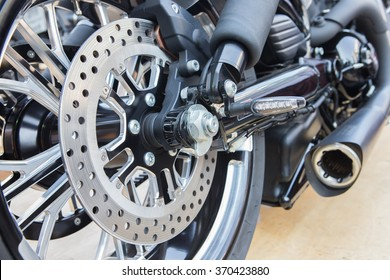 Close up and selective focus motorbike wheel and break detail