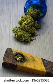 Close up selective focus on marijuana and pipe background