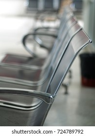 close up selective focus photo of stainless steel chair public furniture for visitors placing on clean floor of a balcony terrace interior in vet animal hospital