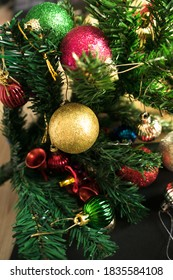 close up and selective focus red wrinkle Christmas ball hanging on Christmas tree for celebrate