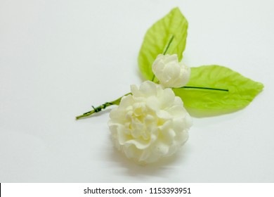Close up : Selective focus at top of white jasmin artifical flower for celebrate mother's day in Thailand on 12 August every year.