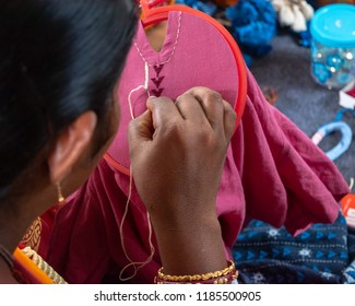 Close up of a Self employment woman working with needle and thread.