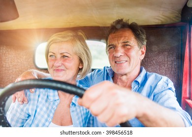 Close up of senior couple inside a pickup truck