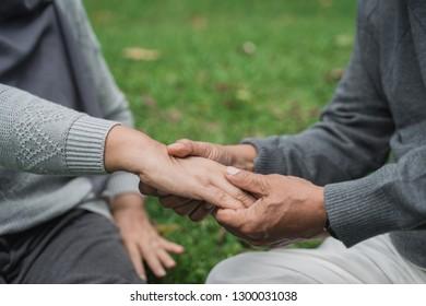 close up of senior  hand massaging on someone's palm