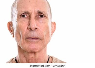 Close up of senior man isolated against white background