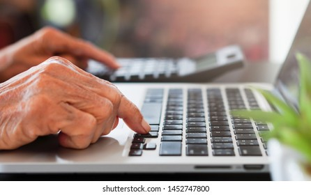 close up senior woman hand typing on keyboard laptop for work about welfare and money monthly after retirement at the table in home office and managing expense