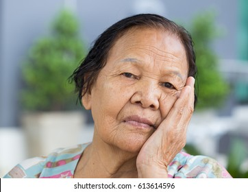 Close up of senior woman with worried stressed face