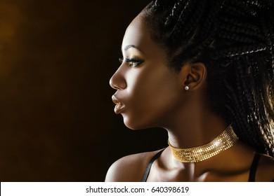 Close up sensual studio portrait of beautiful young african girl.Side view of woman with braided hairstyle.