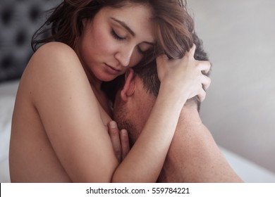 Close up of sensual young couple embracing while having sex. Man and woman in bed making passionate love.