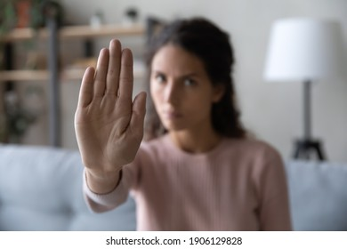 Close up serious confident strong caucasian woman showing stop gesture with hand, protesting about domestic violence or saying no to abuse bullying, denying gender discrimination or abortion. - Shutterstock ID 1906129828