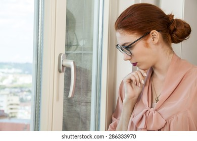 Close up Serious Pretty Office Woman in Stylish Business Attire Looking Outside Through Glass Window
