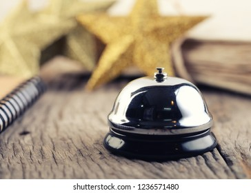Close up service bell with Christmas decorations on wooden -vintage effect style.