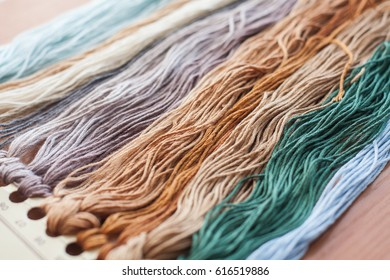Close up set of colorful wool threads. Abstract hobby background