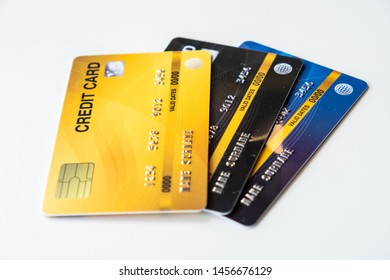 Close up of a set of cradit cards isolated on white background. Credit card lets cardholders borrow funds with which to pay for goods and services depend on the condition that cardholders pay back.