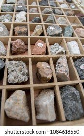 close up of set of minerals and stones inside of a wooden box