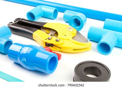 Close up Set plumbing water supply include Blue PVC pipe , fitting joint connector , thread seal tape , saw blade and Pipe cutters isolated on white background