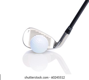 Close up of a seven iron and golf ball on white reflective surface.