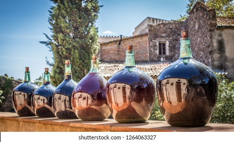 Close up of several big old wine bottles at a winery in Spain
