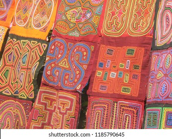 Close up of several tapestries hand made by the Kuna Indians in a rural market in Panama