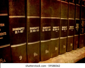Close up of several volumes of law books of codes and statutes on bankruptcy