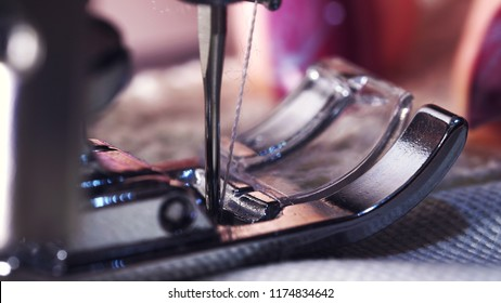 Close up of sewing machine showing process. Item of clothing, vintage style. sewing process in the phase of overstitching. Tailor woman working. Fashion concept.