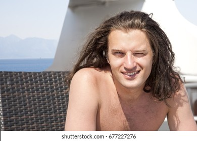 Close up of sexually attractive handsome man smiling and feeling glad.
