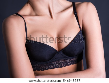 Close Up Of Sexy Female Breast In Black Lace Lingerie