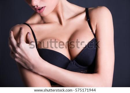 Close Up Of Sexy Female Breast In Black Lace Bra
