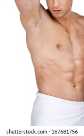 Close up of sexy fit handsome male body. Standing in white towel with nude torso isolated over white background