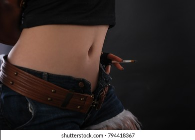 Close up of sexy woman with cigarette. Studio shoot