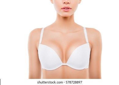 Close up of  sexy woman with perfect chest in white bra.