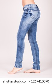 Close up of sexy woman wearing blue jeans. Fit female butt in blue jeans.