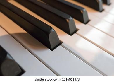 A close up of shade and piano keys
