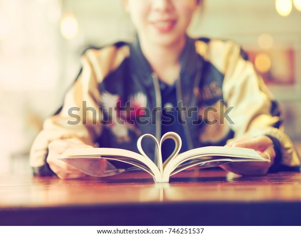 Close up Shape of heart from pages of the book.