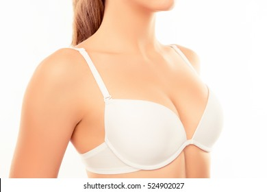 Close up of shapely sexy woman wearing white bra.