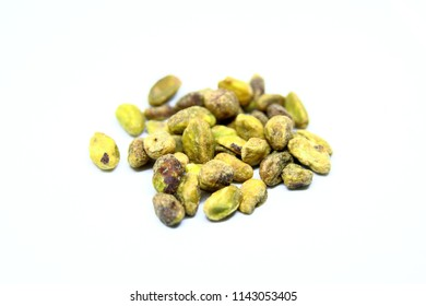 Close up shelled salted pistachios  isolated on white background