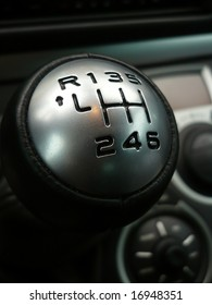 Close up of shift knob with 6 gears in car interior