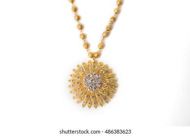 Close up shiny gold  jewelery on white background