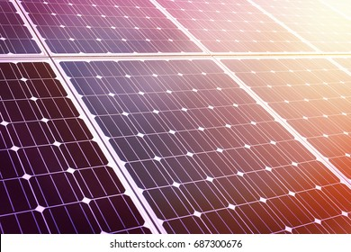 close up of shiny solar energy panel in sunset