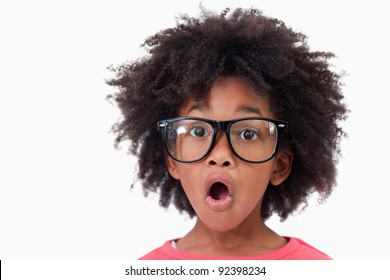 Close up of a shocked smart girl against a white background